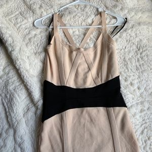 Nude and black Bebe bodycon dress